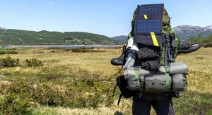 hiker outdoors with solar panel backpack