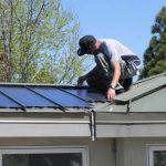 man-installing-solar-panels-on-a-roof