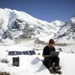 hiker-using-solar-generator-in-the-mountains